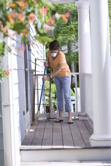 17109-a-woman-sweeping-her-front-porch-pv